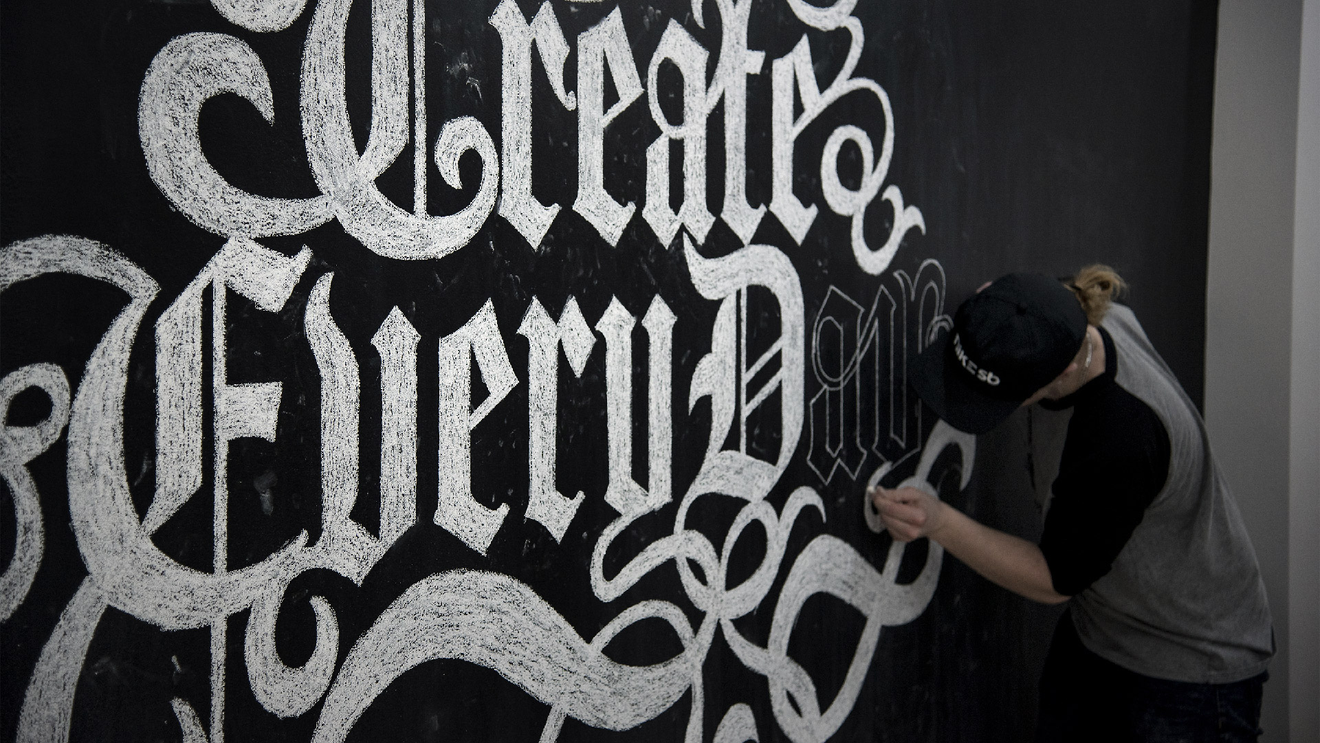 anthony mika installing create every day chalk mural at tyger shark