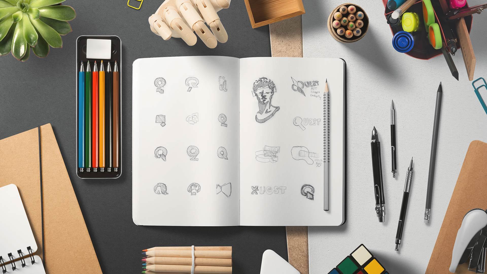 quest art logo sketches in sketch book